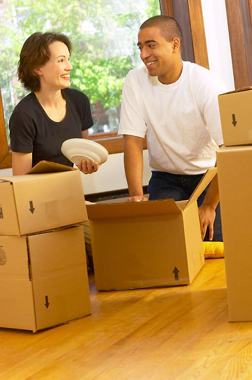 couple with boxes vertical